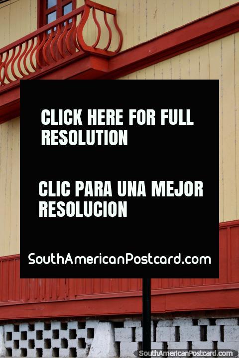 Albino del Curto School (1942) in Limon, wooden facade with balcony at the top. (480x720px). Ecuador, South America.