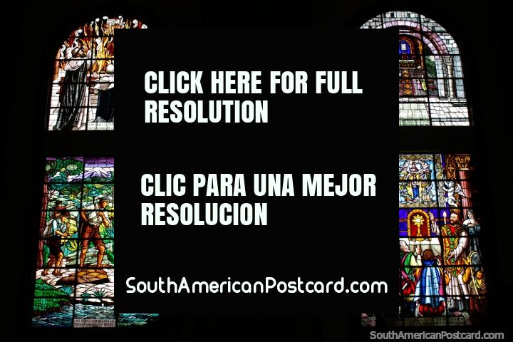 Beautiful stained glass windows with religious themes at the church in Macas. (720x480px). Ecuador, South America.