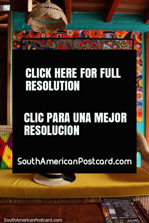 Amazing decor with pillows and a psychedelic painting, Leprechaun Bar, Banos. (480x720px). Ecuador, South America.