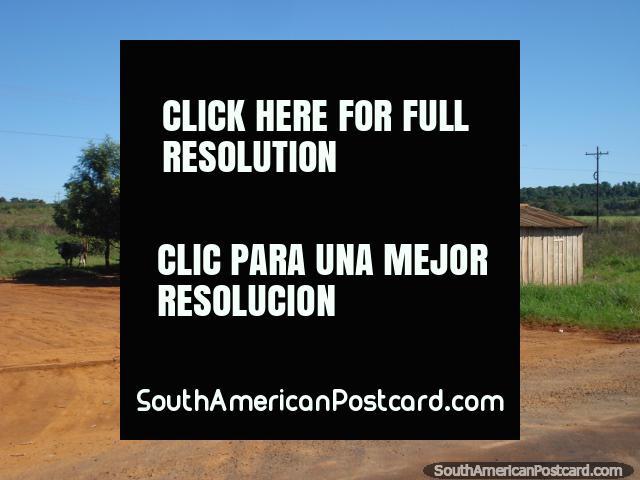 Wooden shed and colorful clay between Ciudad del Este and La Colmena. (640x480px). Paraguay, South America.