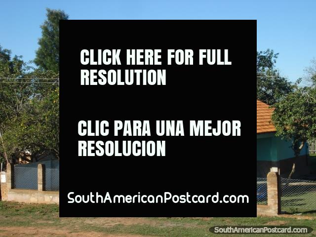 Little house and fenced property in countryside between Paraguari and Ybycui. (640x480px). Paraguay, South America.