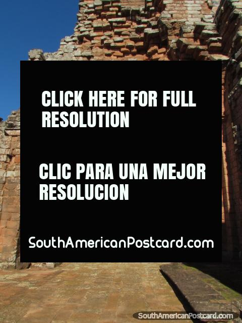 Crumbled stone brick wall and arch at the church Iglesia de Trinidad Piedra. (480x640px). Paraguay, South America.