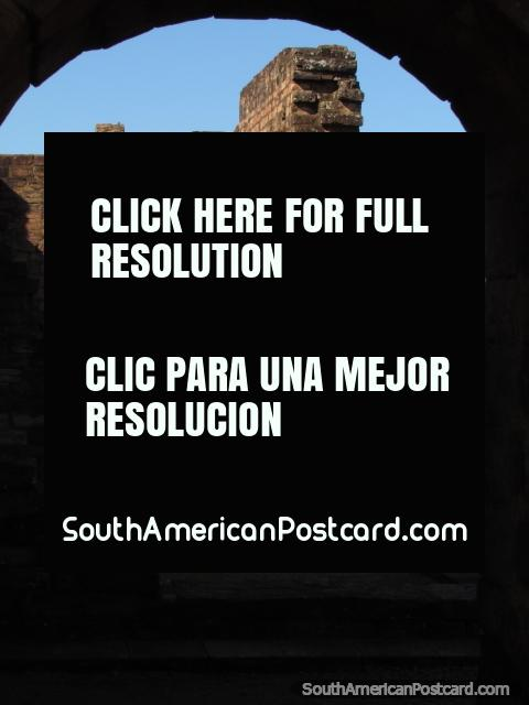View of columns and walls through an arch at the Jesuit ruins of Jesus. (480x640px). Paraguay, South America.