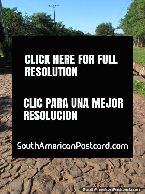 A long cobblestone road in Paraguari. (480x640px). Paraguay, South America.