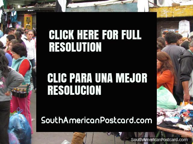 Clothes racks and people, Guasu Markets, Asuncion. (640x480px). Paraguay, South America.