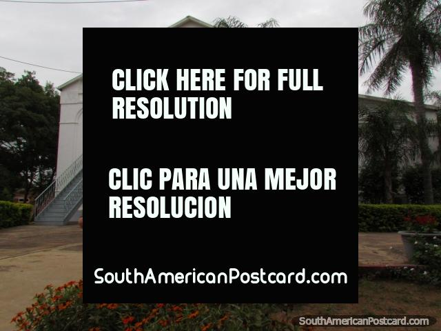 Mennonite church in Filadelfia and red flower gardens. (640x480px). Paraguay, South America.