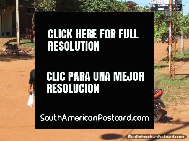 Concepcion modes of transport - walking, motorbike and horse pulled cart. (640x480px). Paraguay, South America.