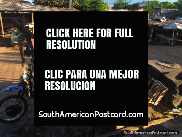 A wooden cart and wooden shacks with roofs of corrugated iron, Concepcion markets. (640x480px). Paraguay, South America.