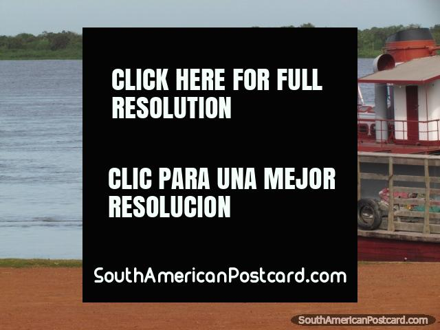 A man rows people across the Paraguay River in Concepcion. (640x480px). Paraguay, South America.