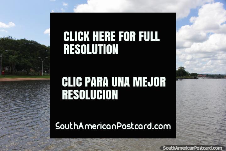 The green shores of Lake Ypacarai at San Bernardino, small passenger boats on the beach. (720x480px). Paraguay, South America.