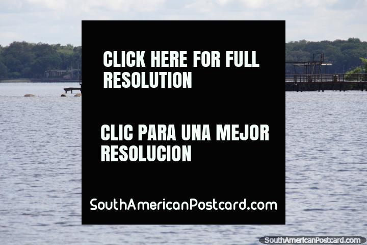 Las aguas abiertas del lago en San Bernardino, embarcaderos sobresalen. (720x480px). Paraguay, Sudamerica.