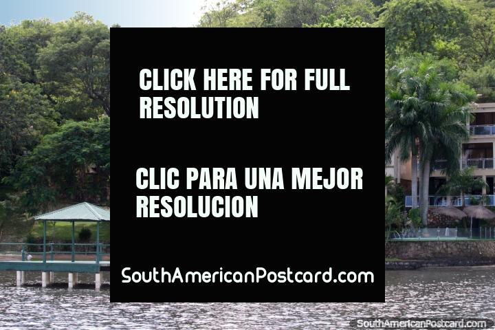 A mansion or hotel with private jetty on the waters edge at San Bernardino. (720x480px). Paraguay, South America.
