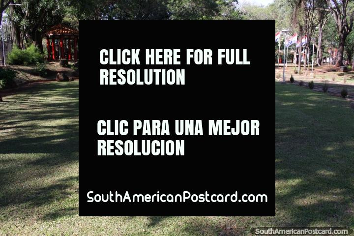 The green lawn, flags and red Chinese hut at Parque Chino in Ciudad del Este. (720x480px). Paraguay, South America.