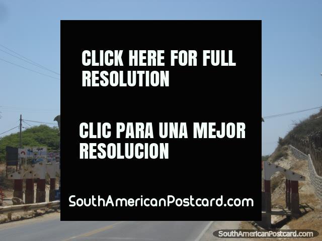 Bienvenidos a Mancora, the road and arch that lead into Mancora on the far north coast. (640x480px). Peru, South America.