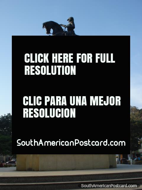 Man on horse statue in the plaza de armas in Pisco. (480x640px). Peru, South America.