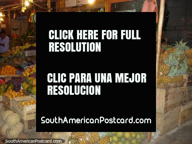 Fruit shop with tons of fruit at the night market in Piura. (640x480px). Peru, South America.