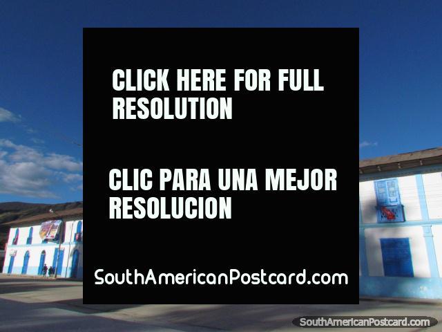 The Celendin clocktower and long blue building. (640x480px). Peru, South America.