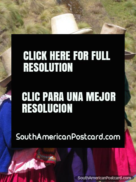 3 peasant girls in hats and pink clothes sing song at Cumbemayo. (480x640px). Peru, South America.