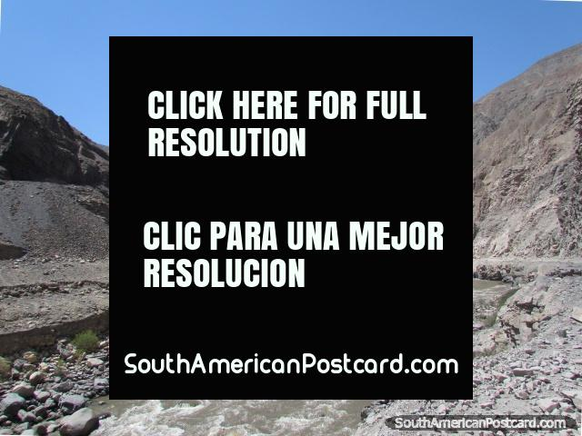 Into the mountains of grey shingle and jagged rocks to Caraz from Chuquicara. (640x480px). Peru, South America.