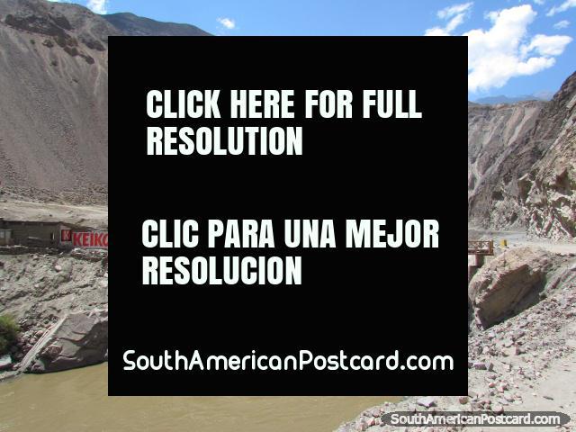Bridge across the river beside the road to Caraz from Chuquicara. (640x480px). Peru, South America.