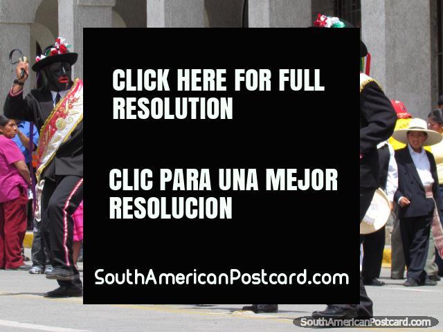 The black face, red lipped mumbo jumbo men perform in Huaraz celebrations. (640x480px). Peru, South America.