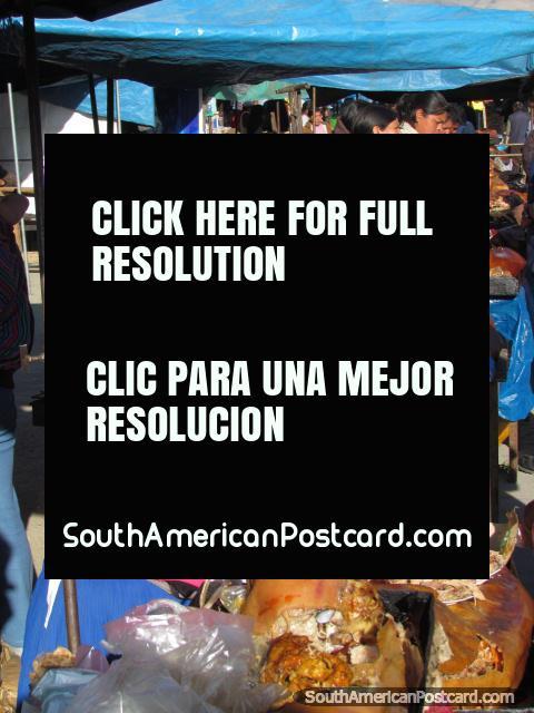 Fresh pork stalls at Andahuaylas markets. (480x640px). Peru, South America.