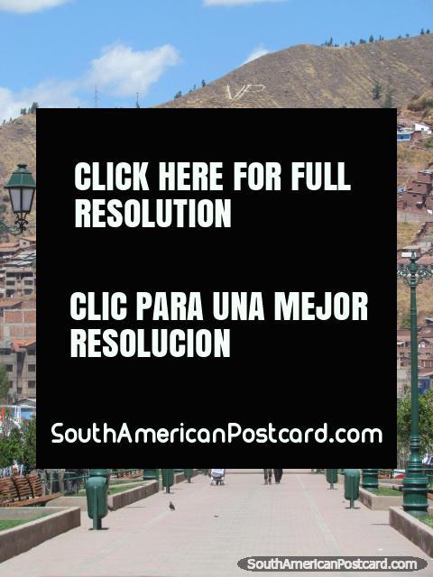 Walking towards the Pachakuteq Monument in Cusco. (480x640px). Peru, South America.