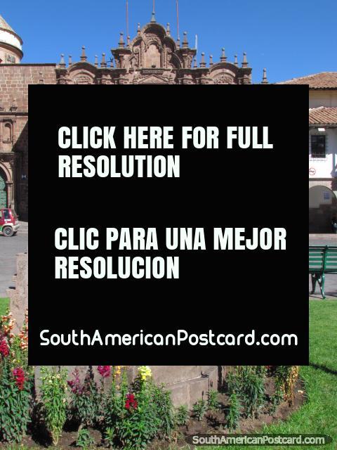 Flower gardens and the church of La Compania in Cusco. (480x640px). Peru, South America.