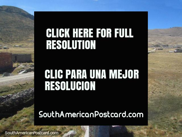 Terrain and long straight road north/west of Desaguadero. (640x480px). Peru, South America.