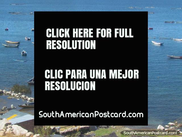Many small fishing boats and nets on Lake Titicaca. (640x480px). Peru, South America.