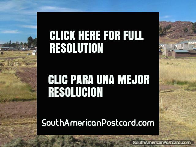 A community and hill around the area of Huisahuinica near Titicaca. (640x480px). Peru, South America.