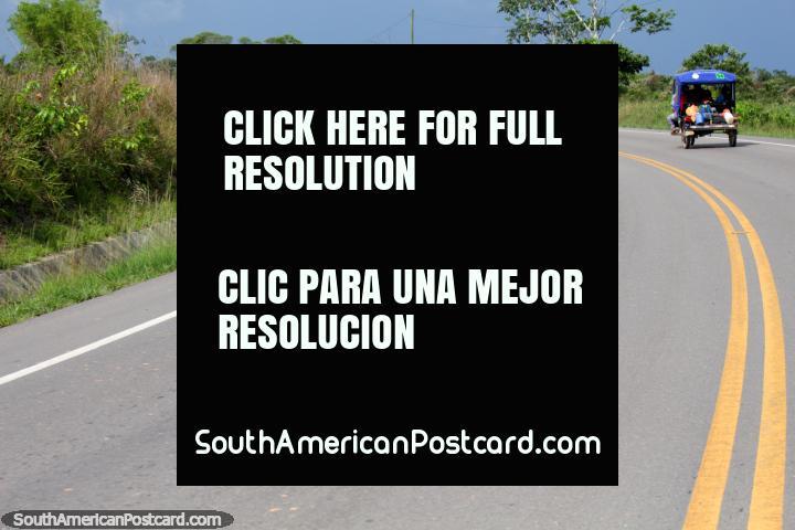 Even mototaxis travel the roads of the Amazon, Pucallpa to Tingo Maria. (720x480px). Peru, South America.
