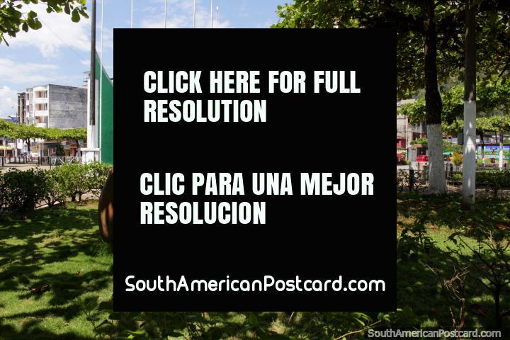 The park behind the flag poles around the Plaza de Armas in Tingo Maria. (720x480px). Peru, South America.