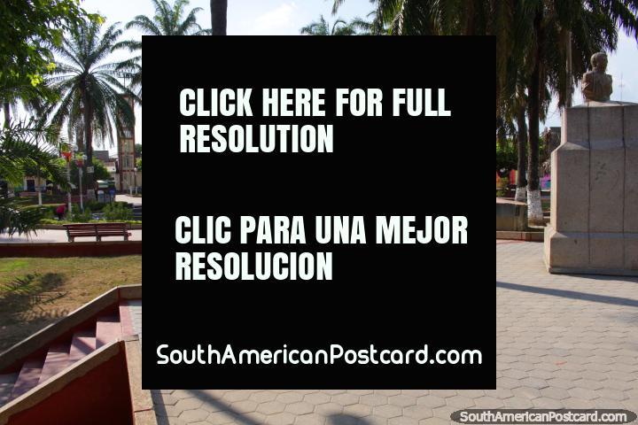 Church in the distance, bronze bust, Plaza de Armas, Tocache. (720x480px). Peru, South America.