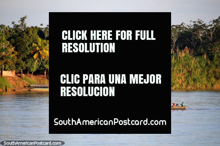 Motorized river canoe powers up the Huallaga River near Yurimaguas. (720x480px). Peru, South America.