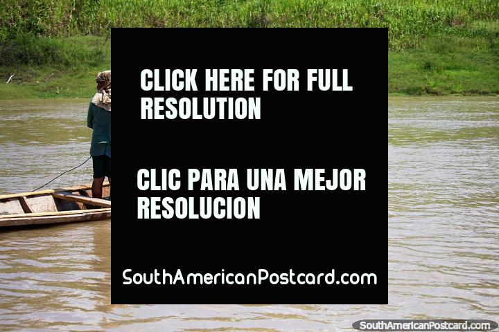 A man and son set fishing nets in the Amazon River in Alfaro, west of Santa Rosa. (720x480px). Peru, South America.