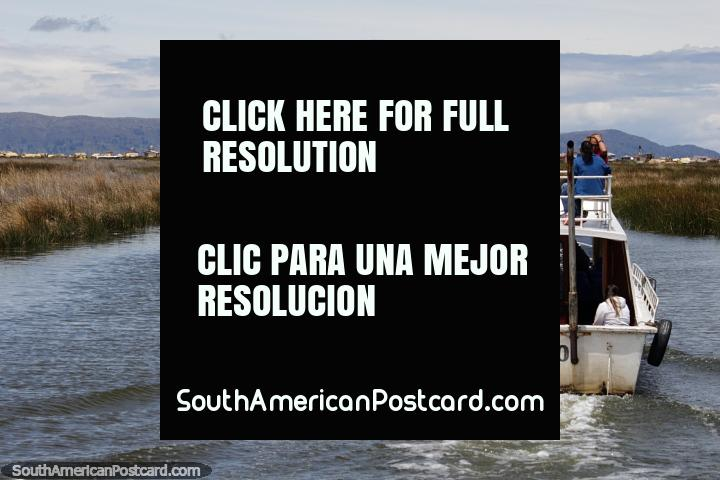 Tours from Puno will take you out onto the lake for a great journey. (720x480px). Peru, South America.