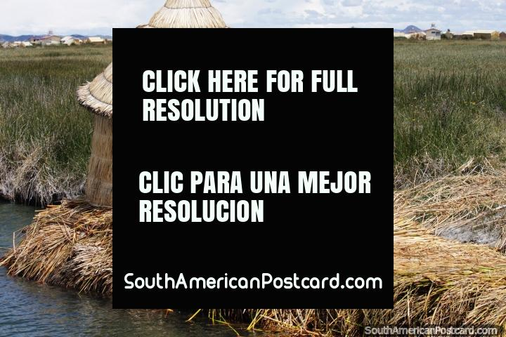 Round thatched hut sitting on floating reeds beside the waters at Lake Titicaca in Puno. (720x480px). Peru, South America.