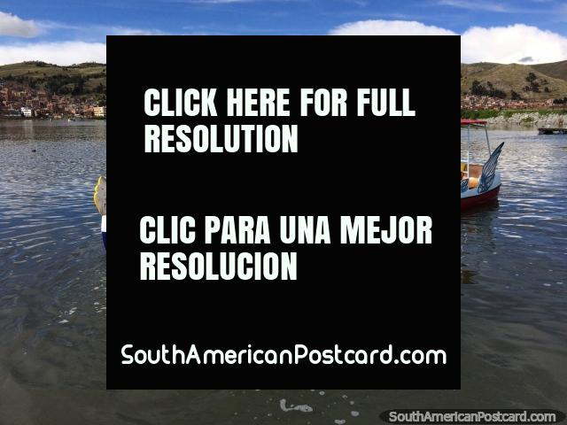 Hire a pedal boat in the shape of an animal near the port in Puno for some fun on the water. (640x480px). Peru, South America.