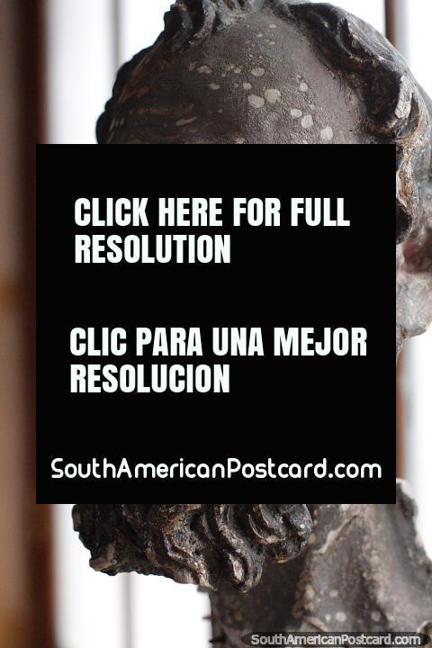Head of a man inside the colonial room, ceramic or bronze, Carlos Dreyer Museum, Puno. (480x720px). Peru, South America.