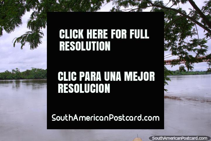 Bridge over the river and calm waters in Puerto Maldonado. (720x480px). Peru, South America.