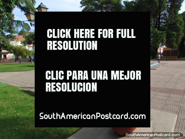 Flowerpot, bench seat, lamp and fountain in Plaza Artigas in Paysandu. (640x480px). Uruguay, South America.
