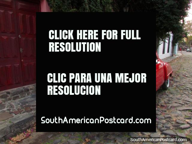 A classic car in red on the cobblestone street in Colonia del Sacramento. (640x480px). Uruguay, South America.