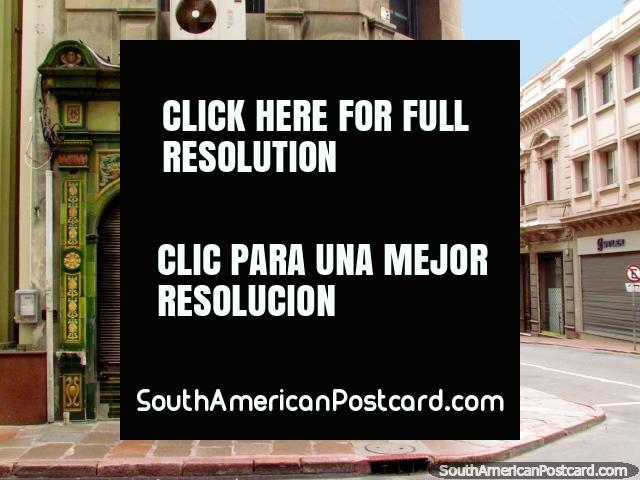 Old building in Montevideo from 1907 with green tiled facade. (640x480px). Uruguay, South America.