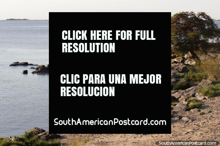 View of the river and people on the rocks in the afternoon around Santa Rita Bastion in Colonia. (720x480px). Uruguay, South America.