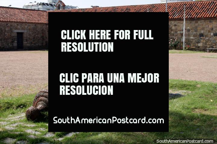Cannon at the plaza of the Dragons Barracks, stone buildings and statue, Maldonado. (720x480px). Uruguay, South America.