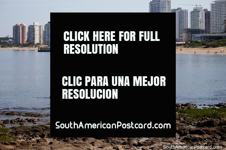 Apartment living at Mansa Beach in Punta del Este with the rocks, jetty and sand. (720x480px). Uruguay, South America.