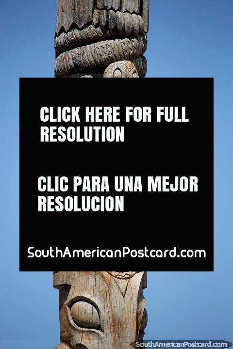 Wooden totem pole with faces dedicated to writer Marcos Sastre (1808-1887), Punta del Este. (480x720px). Uruguay, South America.