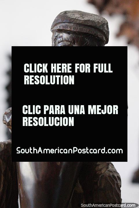 Man plays the bongo drum, wooden sculpture at La Vista gallery in Punta del Este. (480x720px). Uruguay, South America.