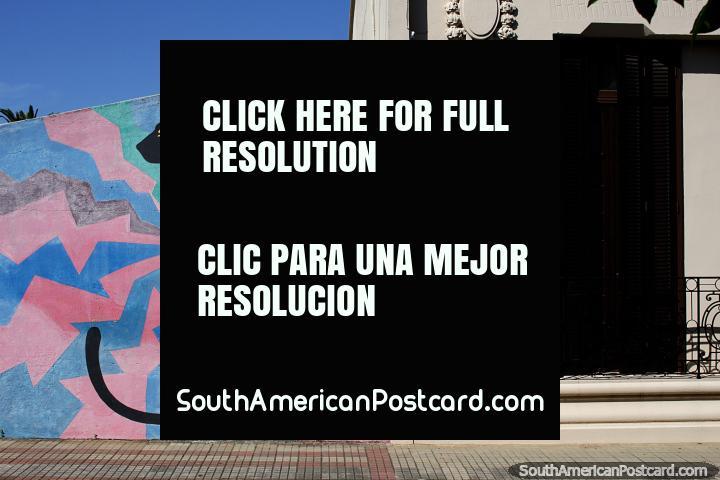 Street art of a black cat in Rocha beside a nice facade in the city street. (720x480px). Uruguay, South America.
